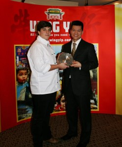 Valerio receives his trophy from Brian Yip - image by Jo's Kitchen