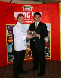 Joseph being awarded his trophy by Brian Yip - Image by Jo's Kitchen