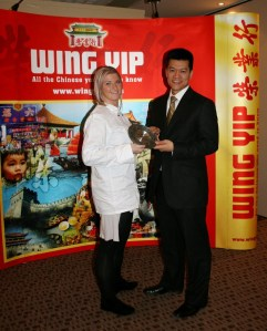 Ruby receives her trophy from Brian Yip - Image by Jo's Kitchen